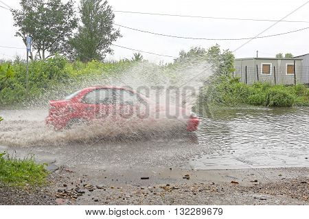 Aquaplaning Vehicle Driving Fast Through Floods Water