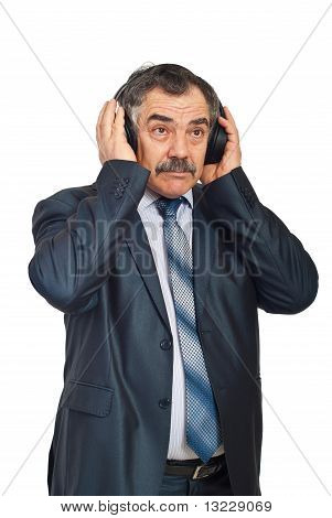 Mature Business Man Listening Music