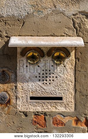 Door bell for apartments in Venice Italy. Resembles a human face.