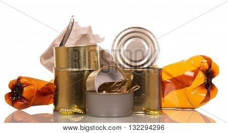 Household waste: plastic bottles, tin cans, cardboard and cork isolated on white background.