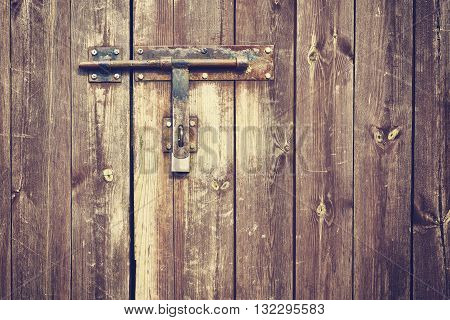 Vintage Stylized Old Metal Hasp On Wooden Door.