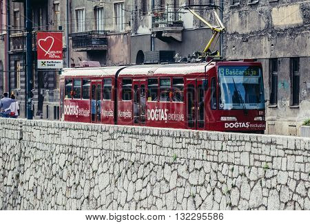 Sarajevo Bosnia and Herzegovina - August 23 2015: red tram car at Obala Kulina Bana Street in Sarajevo city