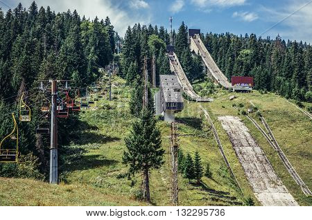 Ilidza Bosnia and Herzegovina - August 24 2015. Abandoned Olympic Jumps on the mountain of Igman in Ilidza. The Objects was built for Winter Olympic Games in 1984