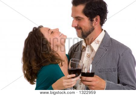Happy Young Couple - Enjoying A Glass Of Wine