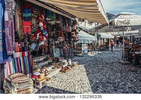 Mostar Bosnia and Herzegovina - August 25 2015. Famous paved Mala Tepa Street with many tourist shops and restaurants in Mostar