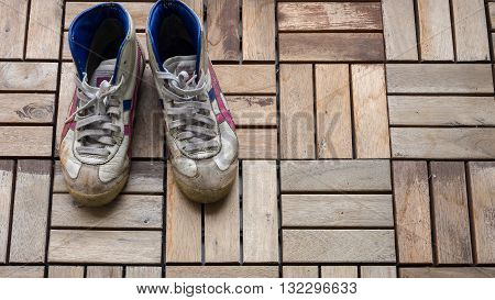 Dirty sneaker shoes old sneaker shoes a pair of sneaker shoes on the wooden floor