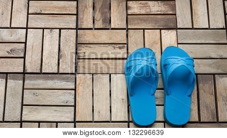 Blue beach sandals flip flop slippers shoes on grunge wooden floor