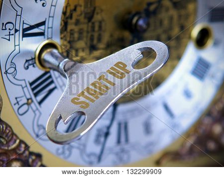 The idea starts a business as a key starts the clock Concept - with shallow depth of field