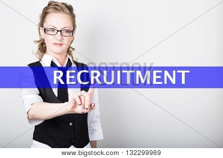 recruitment written on a virtual screen. Internet technologies in business and tourism. woman in business suit and tie, presses a finger on a virtual screen.