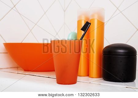 usual stuff in bathroom, shampoo, accessories, black stylish toothbrush, casual normal real background noone