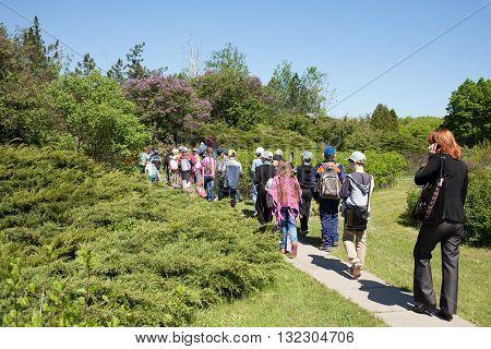 Excursion children in a public botanical garden in the city of Krivoy Rog in Ukraine