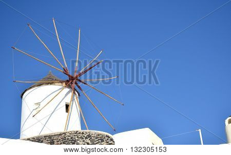 Spectacular Santorini landscape with windmill - Greece