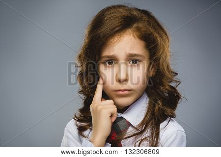 Closeup crying girl with worried stressed on gray background.