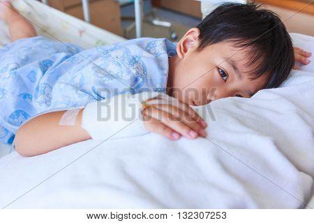 Asian Boy Lying On Sickbed, Saline Intravenous (iv) On Hand.