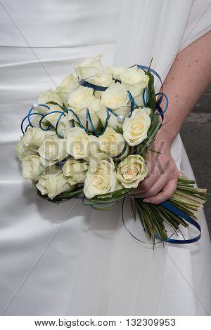 Tender Wedding Bouquet, Cream Roses Flowers In Hands Of Bride