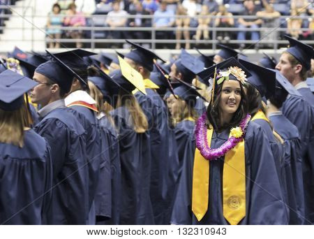 FLAGSTAFF, ARIZONA, MAY 13. Northern Arizona University on May 13, 2016, in Flagstaff, Arizona. A young woman wears a lei for Graduation at the Northern Arizona University Commencement 2016.