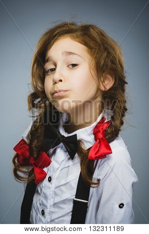 Portrait of offense girl isolated on gray background. Negative human emotion, facial expression. Closeup.