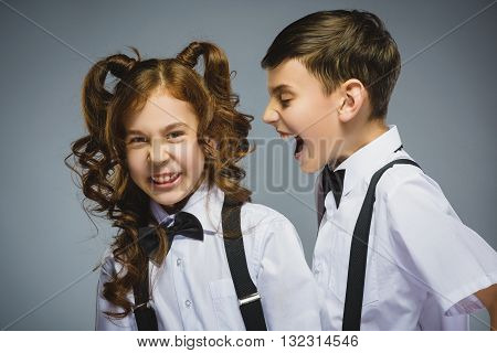 angry boy shouting at frightened dissatisfied girl. Negative human emotion, facial expression. Closeup. Communication concept.