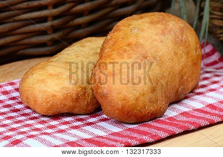 Pasties stuffed meat on a dark wood background, selective focus