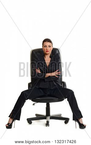 confident business woman sitting in chair on white