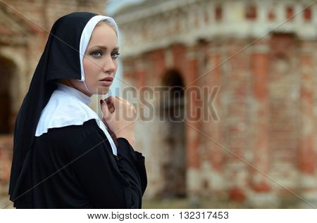portrait of a young nun outdoor