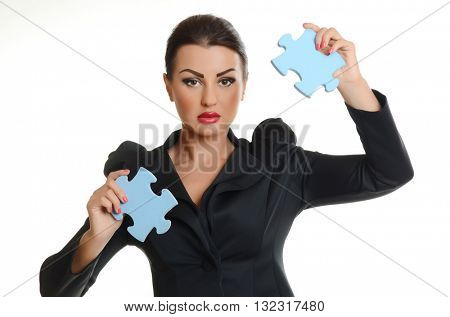 Young  confident business woman joining two jigsaw puzzle pieces on white background