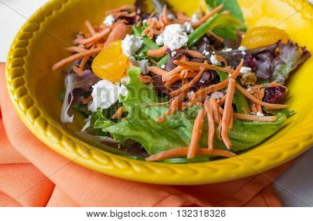 Fresh mexican salad with shredded carrots blue cheese and mandarin orange