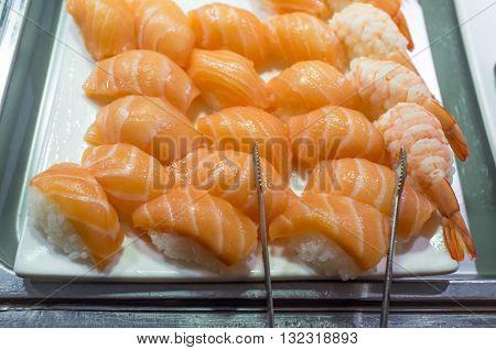 Salmon and shrimp sashimi buffet platter self service