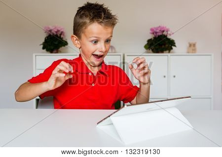 Thrilled Boy With Tablet
