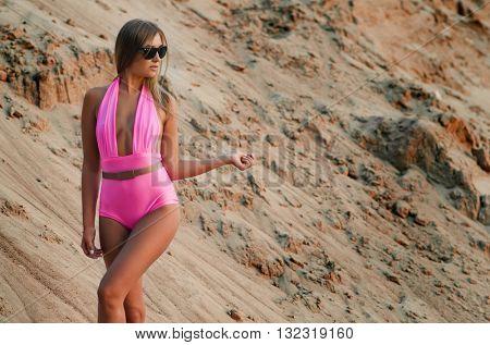 The beautiful woman in bikini on sand