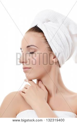 Spa beautiful woman isolated on white background.Touches the face