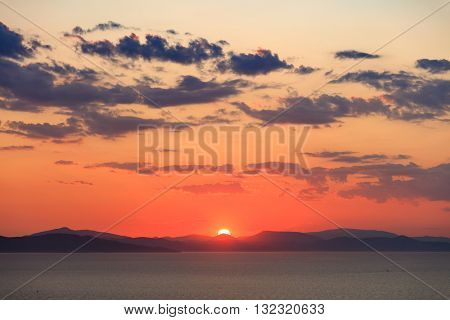 View on picturesque sundown at mountain seascape