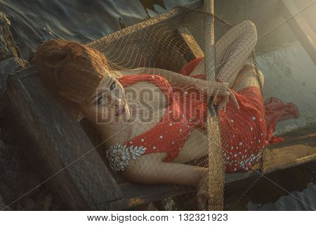 Beautiful Woman in red dress on the boat