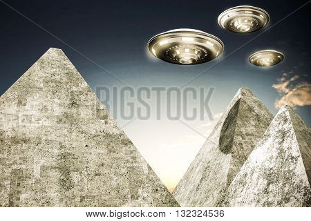 3d illustration of ufo over old pyramids