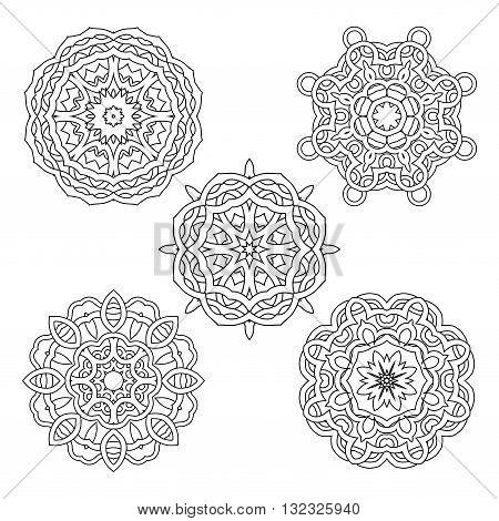 Vector set from four round black and white mandalas. Vector mandalas. Ethnic decorative elements. Hand drawn mandalas.