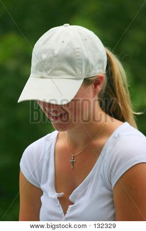 Young Lady With White Baseball Hat