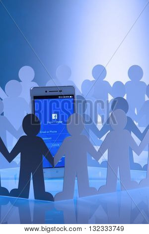 Kuala Lumpur Malaysia, 28th may 2016,Group of people man surrounding  at social network facebook sign in page on smartphone