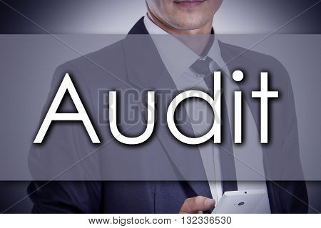 Audit - Young Businessman With Text - Business Concept