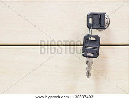 Closeup keys at the wooden drawer texture background