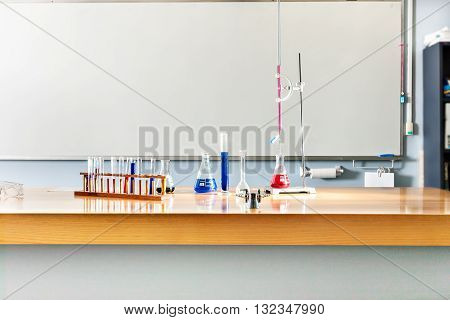 Laboratory Items On The Table With A White Board