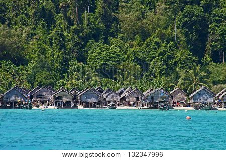 The Moken Sea Gypsy Village at Koh Surin Tai in the Mu Ko National Park Surin Islands of Thailand with its thatched houses on stilts.