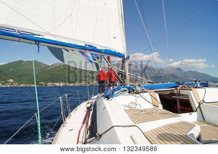 Tivat, Montenegro - 26 April, Some people on the boat with the bow, 26 April, 2016. Regatta