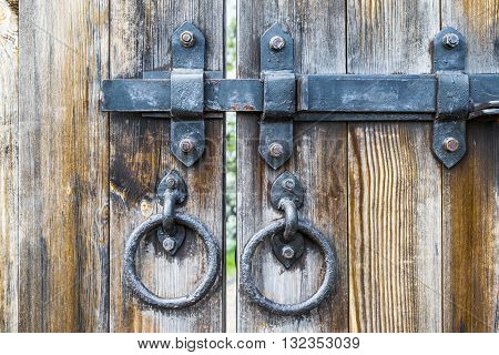 The latch on the old wooden gate in the Moscow Park Kolomenskoe. Russia.