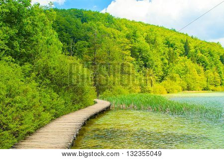 Beautiful landscape, clear green water and wooden trail in the Plitvice Lakes National Park in Croatia