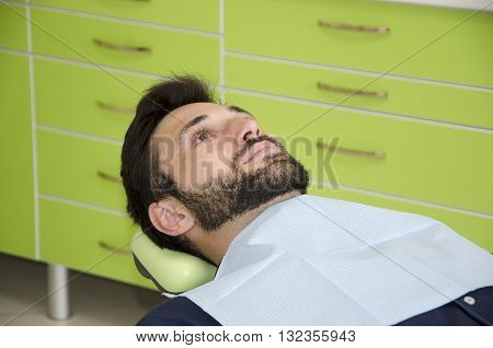 Patient in a dental chair. Young man in dental chair