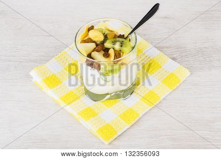 Muesli With Slices Of Fruits And Corn Flakes In Glass