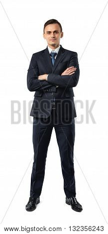Businessman in an elegant  black suit stands with folded arms isolated on a white background. Cutout portrait. Business staff. Office clothes. Dress code. Presentable appearance. Successful lifestyle.