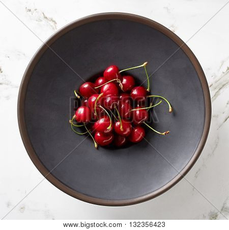 Bowl Of Cherries On Marble Table, From Above
