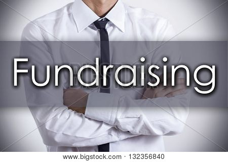 Fundraising - Young Businessman With Text - Business Concept