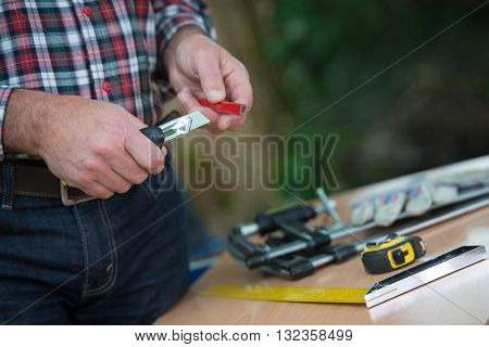Sharpening Of A Carpenter's Pencil With A Blade Knife